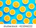 fresh orange slices patterned... | Shutterstock . vector #411046222
