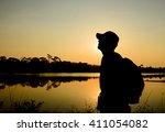 Silhouette Of A Backpacker...