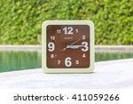 clock on concrete floor at 03... | Shutterstock . vector #411059266