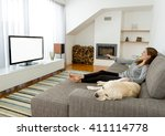 beautiful woman at home with... | Shutterstock . vector #411114778