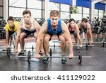 athletic men and women working... | Shutterstock . vector #411129022