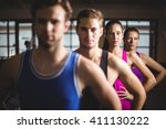 fit people with hands on hips... | Shutterstock . vector #411130222