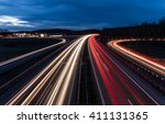 white and red car light trails on motorway junction - stock photo