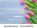 Stock photo tulips on a blue background with copyspace 411146452