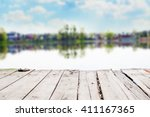 Old Wooden Pier On A Lake At...