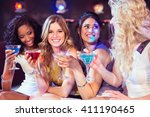pretty girls with cocktails in... | Shutterstock . vector #411190465