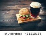 glass mug of dark beer with... | Shutterstock . vector #411210196