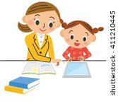 child who learns with a tablet   Shutterstock .eps vector #411210445