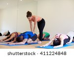 instructor with yoga class at... | Shutterstock . vector #411224848