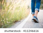Stock photo walking women jeans and sneaker shoes 411246616