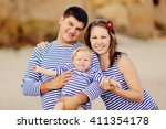 the loving careful parents on... | Shutterstock . vector #411354178