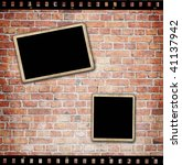 blank photo frames on brick wall | Shutterstock . vector #41137942