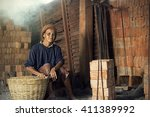 Small photo of Poor Labor in Brick Kiln : Thailand