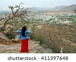 young  woman tourist enjoying... | Shutterstock . vector #411397648