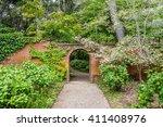 a hidden brick arched gate is...   Shutterstock . vector #411408976