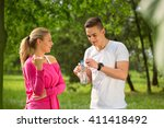 running couple talking in the... | Shutterstock . vector #411418492
