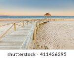 Wooden boardwalk to the beach. Idyllic scene in Trafalgar coast, Cadiz, Spain.