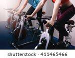 woman on fitness exercise bike... | Shutterstock . vector #411465466