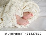 children's feet  wrapped in a... | Shutterstock . vector #411527812