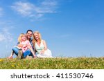 Parents And Daughter Sitting O...