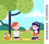 boy and girl kids having lunch... | Shutterstock .eps vector #411539032