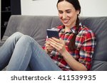 smiling woman is doing... | Shutterstock . vector #411539935