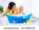 happy baby taking a bath... | Shutterstock . vector #411586576