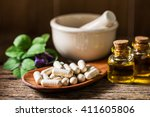 capsule pill with herb ... | Shutterstock . vector #411605806