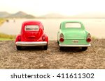 couple toy car park at view... | Shutterstock . vector #411611302