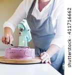 trim the cream icing on a lilac ... | Shutterstock . vector #411716662