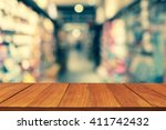 wood table top on blur retro... | Shutterstock . vector #411742432