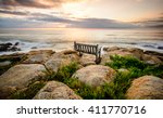 Bench Overlooking A Sea Sunset