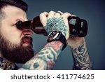 Bearded Hipster Man Holding...