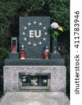 Small photo of Gravestone with symbol of European union as metaphor of disintegration and collapse of EU because of problems (Euro, Grexit, Brexit, Visegrad four, Schengen area, refugee / migrant crisis, terrorism)