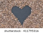 chia. seeds on black stone... | Shutterstock . vector #411795316