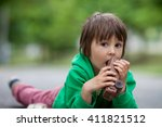 funny little boy playing with... | Shutterstock . vector #411821512