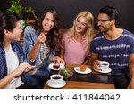 smiling friends enjoying coffee ... | Shutterstock . vector #411844042