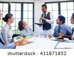 waiter serving water to the... | Shutterstock . vector #411871852