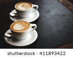 two cups of cappuccino with... | Shutterstock . vector #411893422