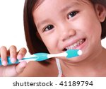 close up of little girl brushing her teeth - stock photo