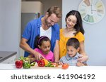 happy family in the kitchen... | Shutterstock . vector #411904192