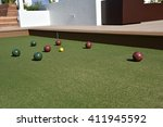 Inviting outdoor terrace bocce ball court made of artificial turf. - stock photo