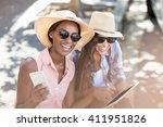 young women having fun while...   Shutterstock . vector #411951826