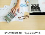 hand of accountant analyzing... | Shutterstock . vector #411966946