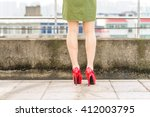 woman's legs  in red high heel... | Shutterstock . vector #412003795