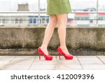woman's legs  in red high heel... | Shutterstock . vector #412009396