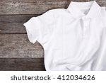 white shirt on the wooden table | Shutterstock . vector #412034626