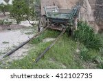 old cart overgrown with grass.... | Shutterstock . vector #412102735