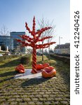 Small photo of STUTTGART, GERMANY - MARCH 18, 2016: Modern art. Red tree (Roter Baum) by sculptor Mariella Mosler, 2005. Stuttgart is the capital and largest city of the state of Baden-Wuerttemberg.