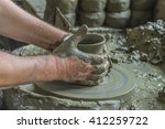 hands of potter working with... | Shutterstock . vector #412259722